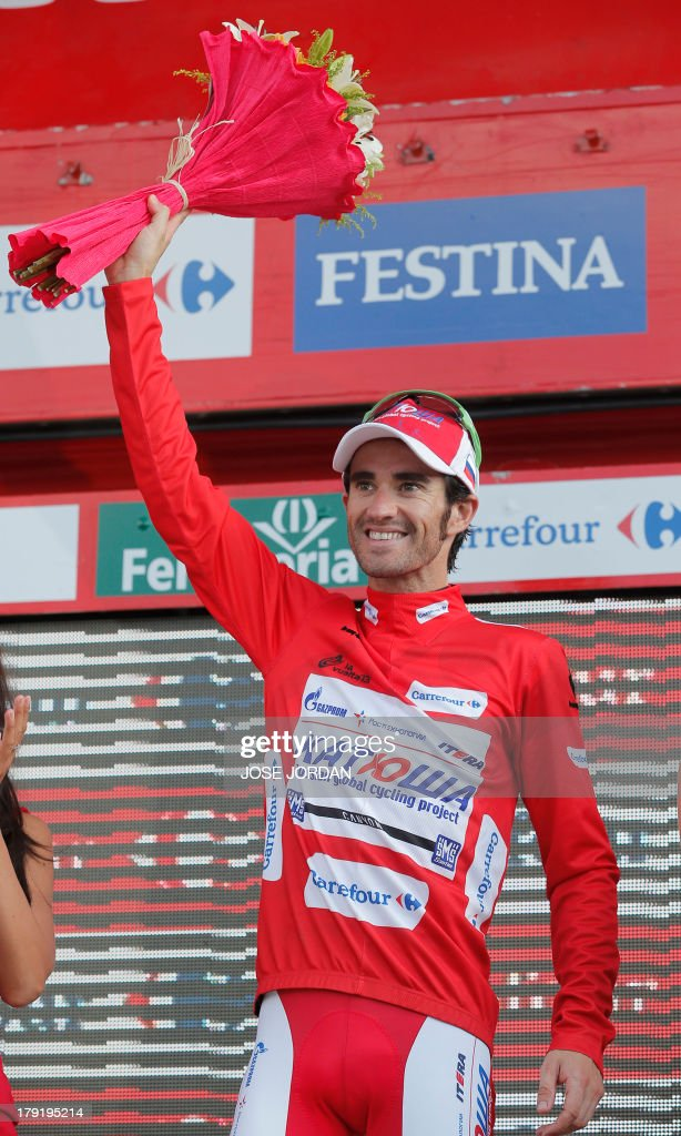 Spaniard Daniel Moreno (Katusha) celebrates his victory and new red jersey from the podium on September 1, 2013 after the ninth stage of the 68th edition of 'La Vuelta' Tour of Spain, a 163.7 km route between Antequera and Valdepenas de Jaen. Spaniard Daniel Moreno (Katusha) edged out compatriots Alejandro Valverde (Movistar) and Joaquim Rodriguez (Katusha) by four seconds with overnight leader Nicholas Roche (Saxo) finishing fourth, eight seconds behind.