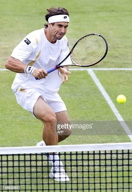 Spaniard David Ferrer returns the ball to Dutch Igor Sijsling on June 21 2012 during their quarterfinal match of the sHertogenbosch grasscourt...