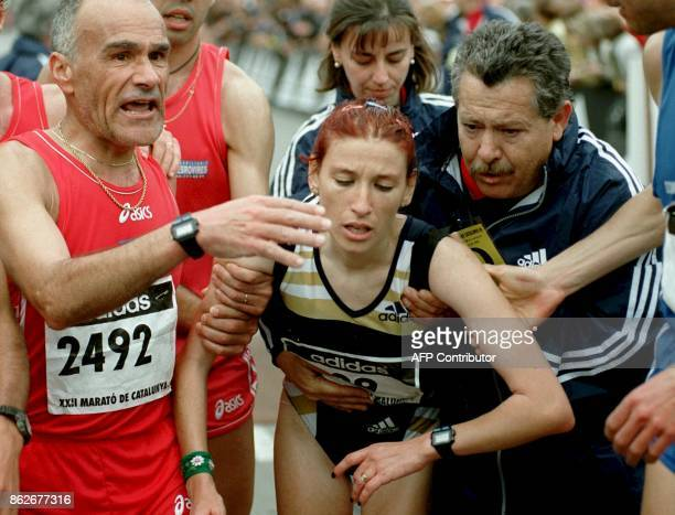 Spaniard Eva Sanz is assisted just after crossing the finish line to win the Cataluna Marathon clocking a time of 02hrs3757 14 March 1999 in...
