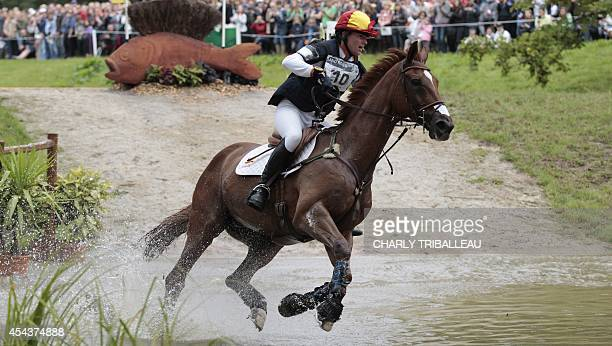 Spaniard Maria Pinedo rides Windsor H on August 30 2014 during the timetable crosscountry test of the 2014 FEI World Equestrian Games at the Haras du...
