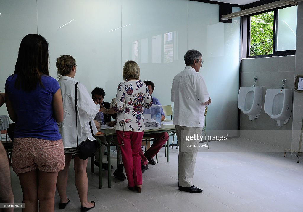 Spaniards cast their vote at a polling station in the Spanish general election on June 26, 2016 in Madrid, Spain. Spanish voters headed back to the polls on June 26 after the last election in December failed to produce a government. Latest opinion polls suggest the Unidos Podemos left-wing alliance could make enough gains to come in second behind the caretaker government of the center-right Popular Party.