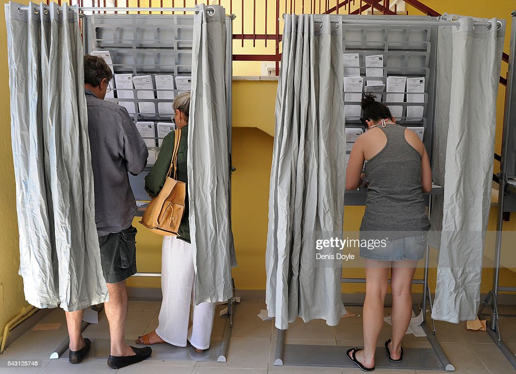 Spaniards cast their votes for the Spanish general election on June 26, 2016 in Madrid, Spain. Spanish voters head back to the polls on June 26 after the last election in December failed to produce a government. Latest opinion polls suggest the Unidos Podemos left-wing alliance could make enough gains to come in second behind the caretaker government of the center-right Popular Party.