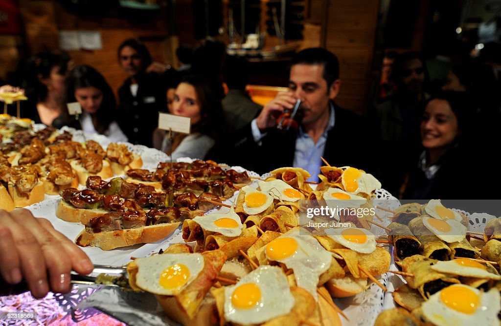 Spaniards enjoy tapas in one of the many tapas bars at Calle Cava Baja on October 23 2009 in Madrid Spain While most restaurants struggle their way...