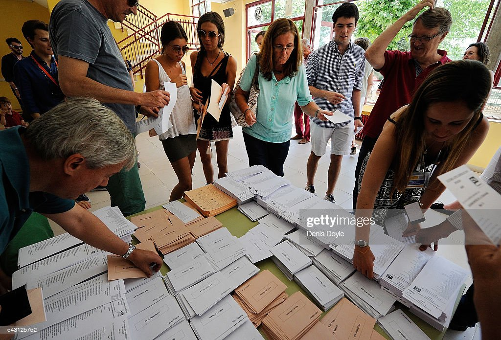 Spaniards select party lists for voting in the Spanish general election on June 26, 2016 in Madrid, Spain. Spanish voters head back to the polls on June 26 after the last election in December failed to produce a government. Latest opinion polls suggest the Unidos Podemos left-wing alliance could make enough gains to come in second behind the caretaker government of the center-right Popular Party.