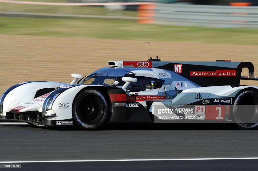 Spanich driver Marc Gene Audi in his R18 E-Tron Quattro Hybrid N°1 competes during the 82nd Le Mans 24 hours endurance race, on June 15, 2014 in Le Mans, western France. Fifty-six cars with 168 drivers are participating on June 14 and 15 in the Le Mans 24-hours endurance race.