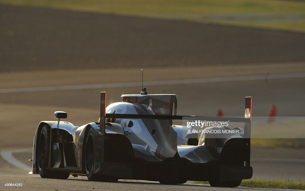 Spanich driver Marc Gene in his Audi R18 E-Tron Quattro Hybrid N°1 competes during the 82nd Le Mans 24 hours endurance race, on June 15, 2014 in Le Mans, western France. Fifty-six cars with 168 drivers are participating on June 14 and 15 in the Le Mans 24-hours endurance race.