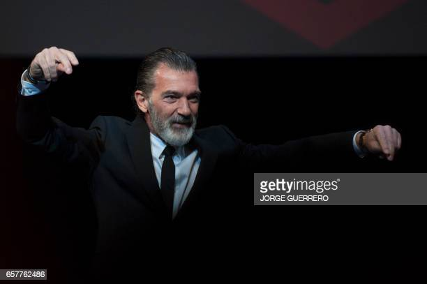 Spanish actor Antonio Banderas dances before receiving the honorary Gold Biznaga award during the 20th International Malaga Film Festival in Malaga...