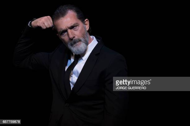 Spanish actor Antonio Banderas gestures before receiving the honorary Gold Biznaga award during the 20th International Malaga Film Festival in Malaga...