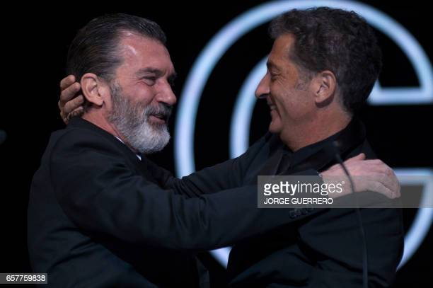 Spanish actor Antonio Banderas hugs his brother Francisco Javier before receiving the honorary Gold Biznaga award during the 20th International...