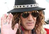 """Spanish actor Antonio Banderas is seen impersonating a rock and roll star during the shooting of his latest movie """"'Salty""""' on July 20 2016 in..."""
