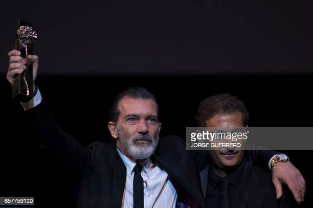 Spanish actor Antonio Banderas poses beside his brother Francisco Javier after receiving the honorary Gold Biznaga award during the 20th...