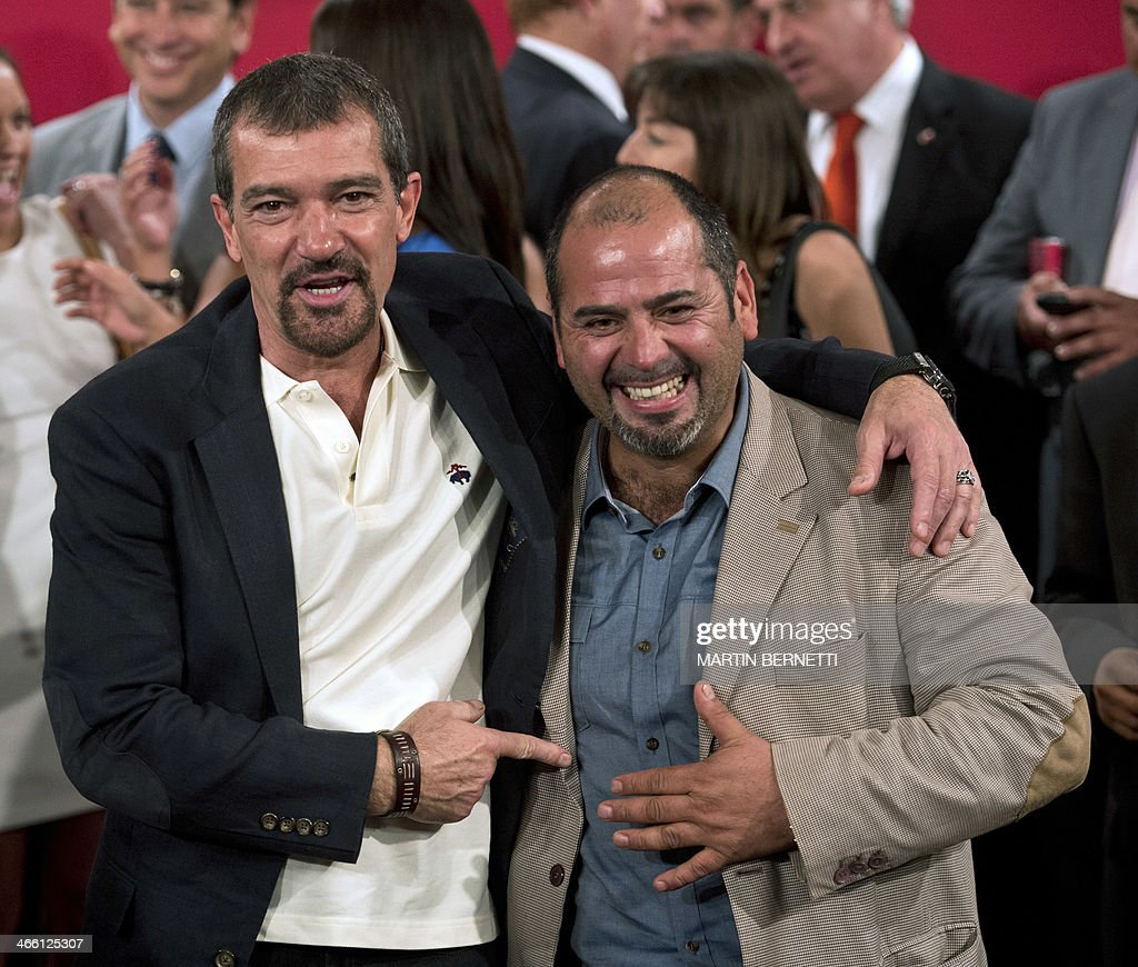 Spanish actor Antonio Banderas poses with rescued Chilean miner Mario Sepulveda at La Moneda presidential palace in Santiago on January 31 2014 where...