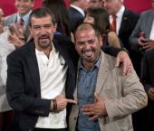 Spanish actor Antonio Banderas poses with rescued Chilean miner Mario Sepulveda at La Moneda presidential palace in Santiago on January 31 2014 where...