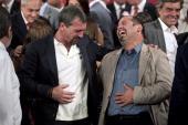 Spanish actor Antonio Banderas shares a laugh with rescued Chilean miner Mario Sepulveda at La Moneda presidential palace in Santiago on January 31...