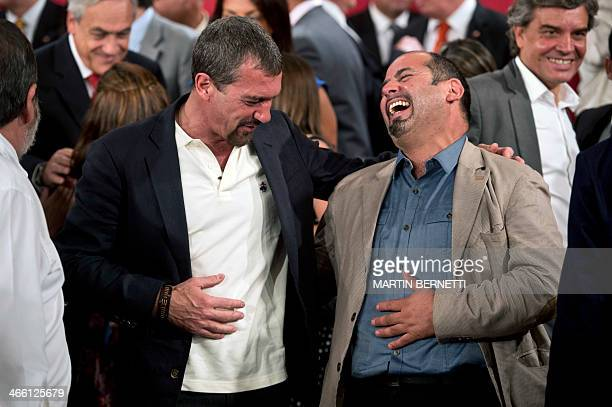 Spanish actor Antonio Banderas shares a laugh with rescued Chilean miner Mario Sepulveda at La Moneda presidential palace in Santiago on January 31...