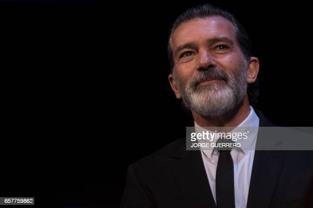 Spanish actor Antonio Banderas smiles before receiving the honorary Gold Biznaga award during the 20th International Malaga Film Festival in Malaga...