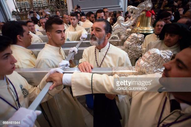 Spanish actor Antonio Banderas takes part in the 'Lagrimas y Favores' brotherhood procession on April 9 2017 in Malaga during the Holy Week Christian...