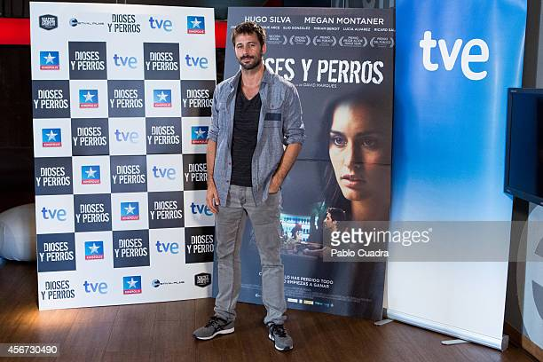 Spanish actor Hugo Silva poses during a photocall to present 'Dioses Y Perros' film at Kinepolis cinema on October 6 2014 in Madrid Spain
