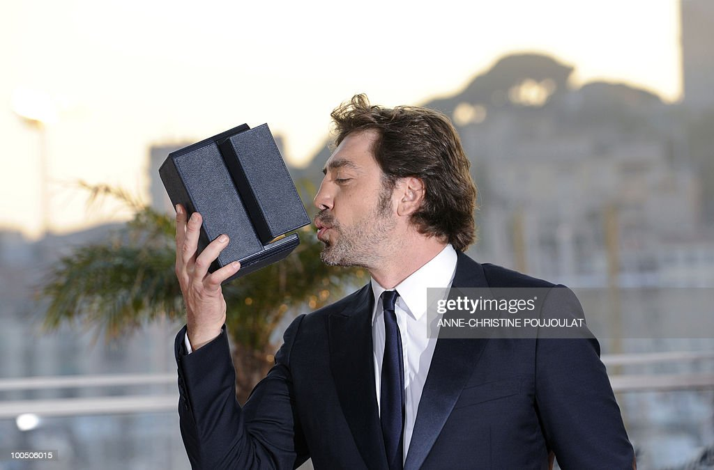 Spanish actor Javier Bardem poses after winning the Best Actor award for his role in 'Biutiful' during the closing ceremony at the 63rd Cannes Film Festival on May 23, 2010 in Cannes.
