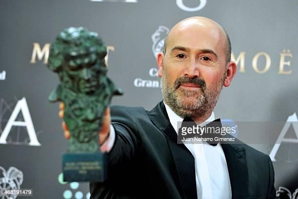 Spanish actor Javier Camara holds his award for best actor in the film 'Vivir Es Facil Con Los Ojos Cerrados' during the 2014 edition of the 'Goya...