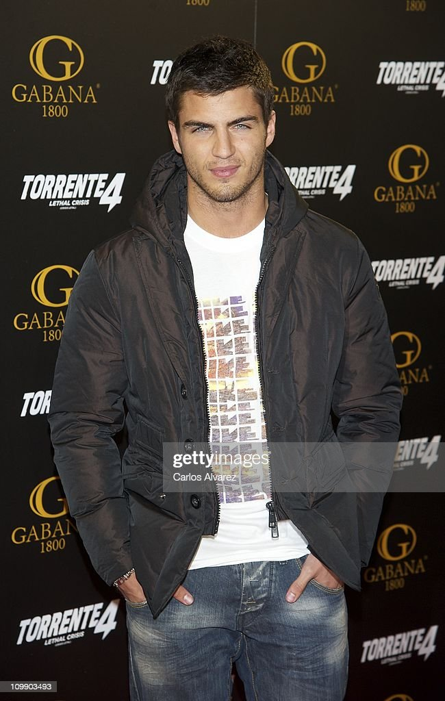 Spanish actor <a gi-track='captionPersonalityLinkClicked' href=/galleries/search?phrase=Maxi+Iglesias&family=editorial&specificpeople=5299677 ng-click='$event.stopPropagation()'>Maxi Iglesias</a> attends 'Torrente 4' premiere at the Capitol cinema on March 9, 2011 in Madrid, Spain.