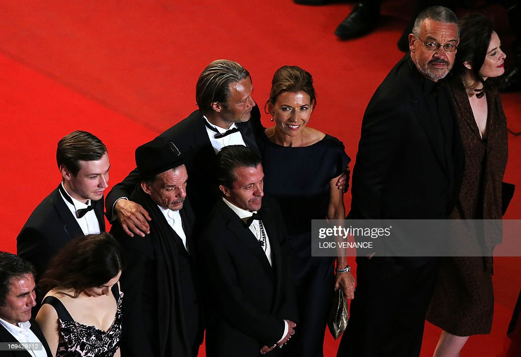 Spanish actor Sergi Lopez, French actress Amira Casar, German actor David Kross, French actor Denis Lavant, Swiss actor David Bennent, Danish actor Mads Mikkelsen and his wife Hanne Jakobsen and French director Arnaud des Pallieres and his partner pose on May 24, 2013 as they arrive for the screening of the film 'Michael Kohlhaas' presented in Competition at the 66th edition of the Cannes Film Festival in Cannes. Cannes, one of the world's top film festivals, opened on May 15 and will climax on May 26 with awards selected by a jury headed this year by Hollywood legend Steven Spielberg. AFP PHOTO / LOIC VENANCE