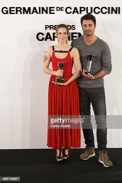 Spanish actors Aura Garrido and Hugo Silva receive the 'Carmen' Germaine de Capuccini award at the Academia de Cine on January 29 2014 in Madrid Spain