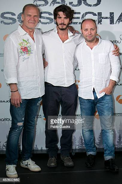 Spanish actors Lluis Homar Yon Gonzalez and Vicente Romero attend 'Bajo Sospecha' Set Filming Presentation in Madrid on July 24 2014 in Madrid Spain