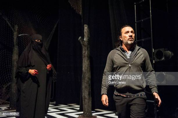 Spanish actors Meme Tabares and Jose Vicente Moiron perform during the dress rehearsal of the play 'Contra la Democracia' by Esteve Soler on stage at...