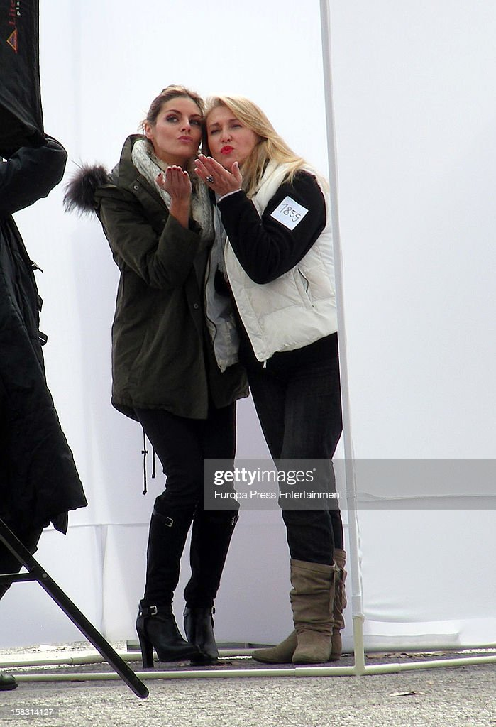 Spanish actress Amaia Salamanca (L) is seen during a photo session for a photographer who is trying to reach a Guiness Record shooting people kissing to fight against the financial crisis on December 12, 2012 in Madrid, Spain.