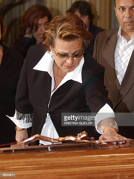 Spanish actress Carmen Sevilla lays her hands on the coffin of Spanish flamenco singer Juanito Valderrama to pay her last respects during his...