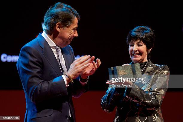 Spanish actress Concha Velasco receives the 'Teather' 2013 award from Madrid Regional President Ignacio Gonzalez at the Theater Canal on December 2...