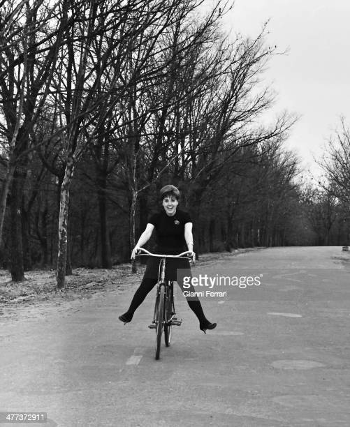 Spanish actress Concha Velasco with her bike in the 'Casa de Campo' Madrid Spain