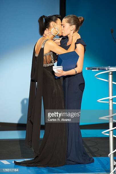 Spanish actress Maria Leon receives from actress Bai Ling the best actress award for her film 'La Voz Dormida' during 59th San Sebastian...