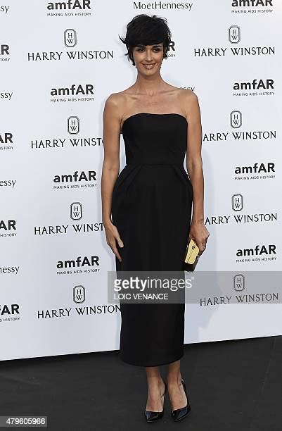 Spanish actress Paz Vega arrives for the Amfar dinner on the sidelines of the Paris fashion week on July 5 2015 in Paris AFP PHOTO / LOIC VENANCE