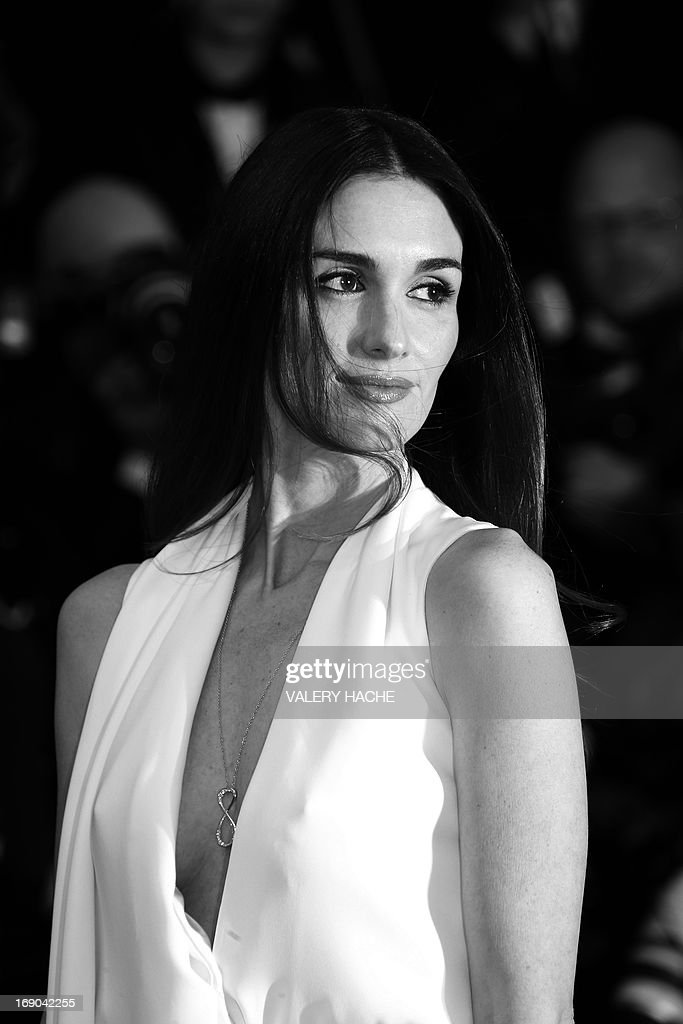 Spanish actress Paz Vega poses on May 18, 2013 as she arrives for the screening of the film 'Jimmy P. Psychotherapy of a Plains Indian' presented in Competition at the 66th edition of the Cannes Film Festival in Cannes. Cannes, one of the world's top film festivals, opened on May 15 and will climax on May 26 with awards selected by a jury headed this year by Hollywood legend Steven Spielberg. AFP PHOTO / VALERY HACHE