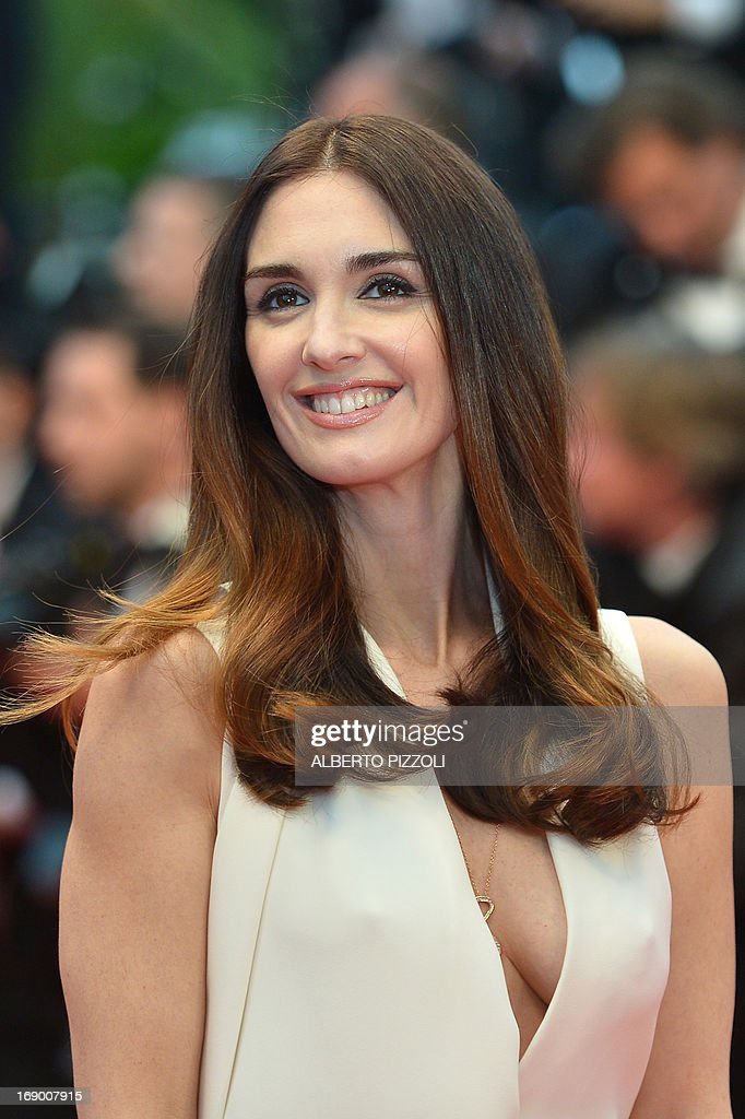 Spanish actress Paz Vega smiles on May 18, 2013 as she arrives for the screening of the film 'Jimmy P. Psychotherapy of a Plains Indian' presented in Competition at the 66th edition of the Cannes Film Festival in Cannes. Cannes, one of the world's top film festivals, opened on May 15 and will climax on May 26 with awards selected by a jury headed this year by Hollywood legend Steven Spielberg. AFP PHOTO / ALBERTO PIZZOLI