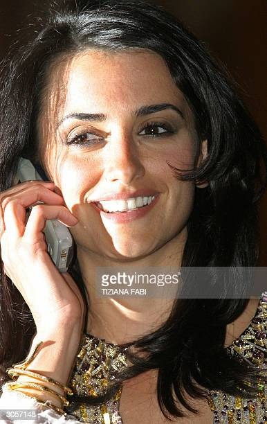 Spanish actress Penelope Cruz answers a telephne call as she poses for photographers 09 March 2004 during the presentation of her latest film 'Non ti...