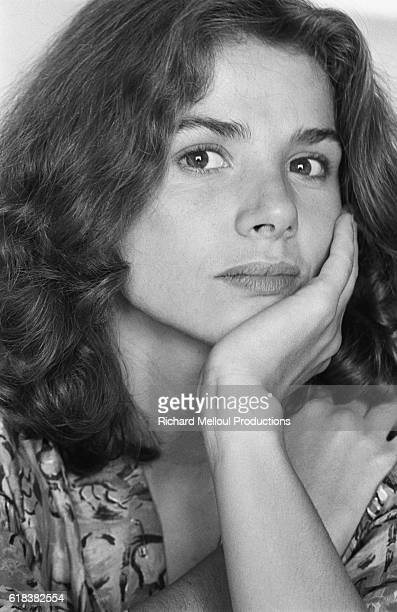 Spanish actress Victoria Abril sits with her chin in her hand in Cannes in 1983