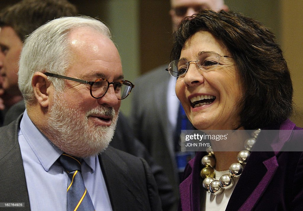 Spanish Agriculture and Environment Minister Miguel Arias Canete (L) talks with EU fisheries and maritime affairs commissioner Maria Damanaki before an Agriculture and Fisheries Council meeting at the EU Headquarters in Brussels on February 26, 2013. AFP PHOTO/JOHN THYS