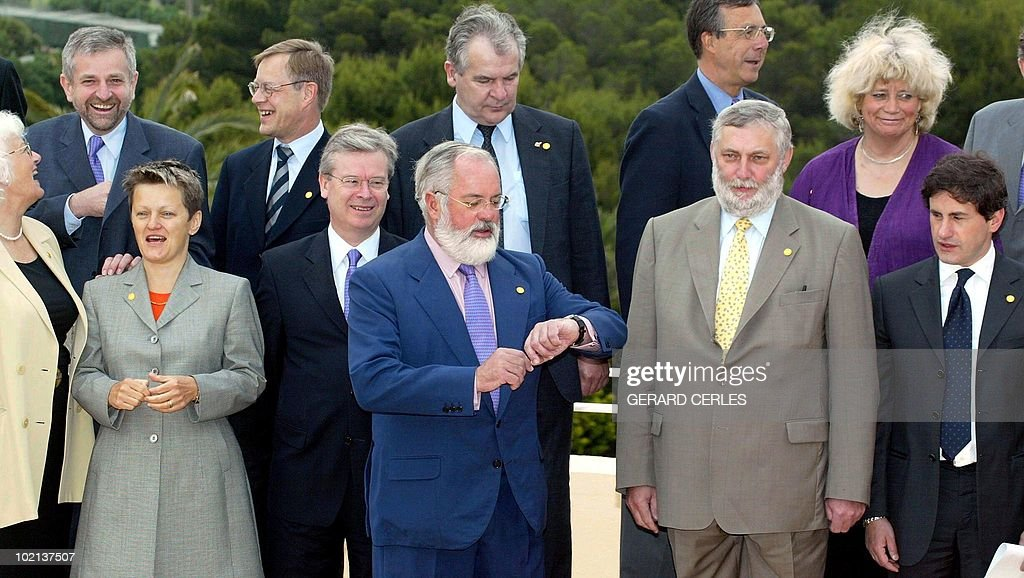 Spanish agriculture minister and current chairman of the council Miguel Arias Canete (C) jokes with his European counterparts during the family picture of the informal council of EU agriculture ministers in La Manga, near Murcia 30 April 2002. (L-R, 1st row) Mariann Fischer Boel of Denmark, Renate Kunast of Germany, EU Commissioner in charge of Health David Byrne, Arias Canete, EU Commissioner in charge of Agriculture Franz Fischler, Giovanni Alemanno of Italy; (L-R, 2nd row) Wilhelm Molterer of Austria, Fernand Boden of Luxembourg, Jose Happart of Belgium, Laurens Jan Brinkhorst of the Netherlands, and Margareta Winberg of Sweden.