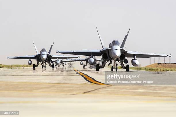 Spanish Air Force EF-18M Hornets taxiing on the runway.