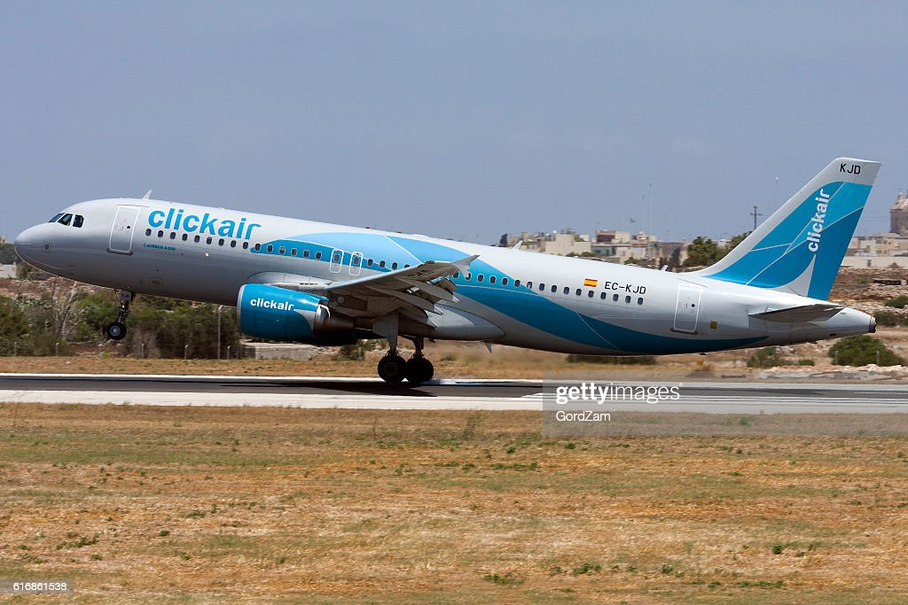 Spanish Airline Clickair Airbus touching down. : Stock Photo