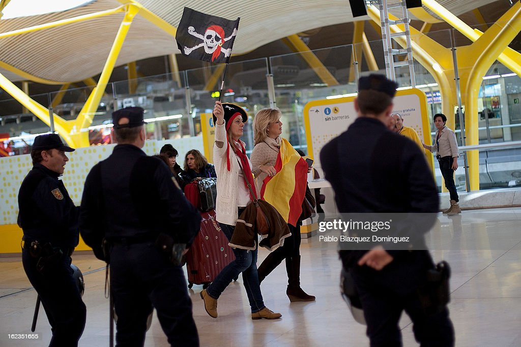 Spanish Airline Iberia staff hold Spanish and pirates flags during a protest against job cuts at Barajas Airport on February 22, 2013 in Madrid, Spain. Today is the last of a five day strike held by Iberia cabin crew, maintenance workers and ground staff in response to the planned loss of 3,800 jobs. The strike has resulted in the airline having to cancel 400 flights this week with unions planning more five day strikes in the following weeks.