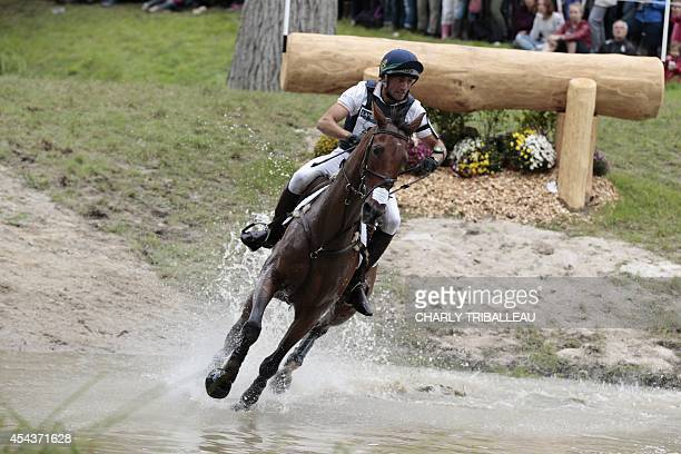 Spanish Albert Hermoso Farras rides Hito CP on August 30 2014 during the timetable crosscountry test of the 2014 FEI World Equestrian Games at the...