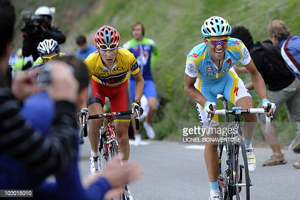 Spanish Alberto Contador rides next to Slovenia's Janez Brajkovic on June 12 during the 1515 km stage run between Crolles and L'Alpe d'Huez during...
