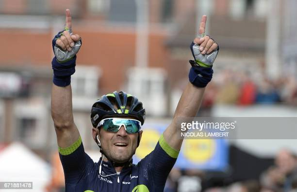 Spanish Alejandro Valverde of Movistar Team celebrates as he crosses the finish line to win the 102nd edition of the LiegeBastogneLiege one day...