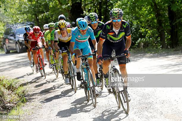 Spanish Alejandro Valverde of Movistar team followed by Italian cyclist Vincenzo Nibali of Astana Pro team in action in the climb on the dirt road...