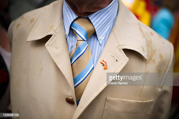 Spanish and Catalan flag pin is seen on the lapel of an antiseparatist Catalan during a demonstration on Spain National Day on October 12 2012 in...