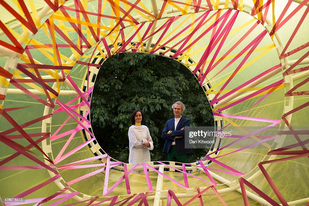 Spanish architects Jose Selgas and Lucia Cano of SelgasCano pose for pictures in the new Serpentine Summer Pavillion on June 22, 2015 in London, England. The Pavilion which officially opens to the public from June 25, 2015, was constructed to celebrate the 15th anniversary of the Serpentine Gallery project. This year the pavilion was designed by Spanish architects Jose Selgas and Lucia Cano and takes the form of a colourful chrysalis structure.